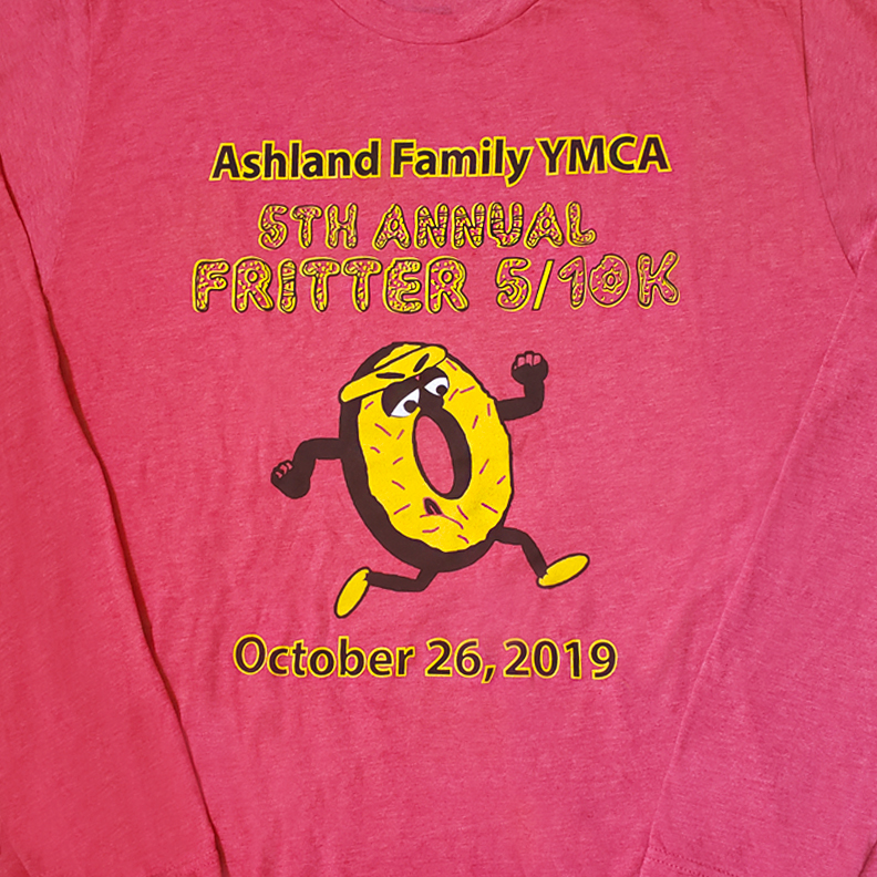 A red shirt with 'Ashland Family YMCA 5th Annual Fritter 5/10 K' on the front. A Fritter with legs runs the marathon.