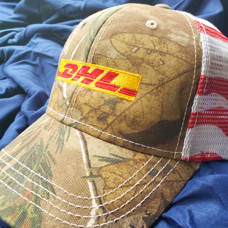 A custom trucker hat with the DHL logo on the front.