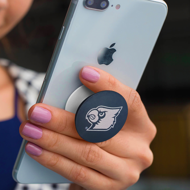 A popsocket with the University of Louisville cardinal head on it.