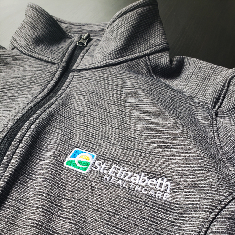 A St. Elizabeth Hospital pullover shirt. The logo is embroidered on the breast.