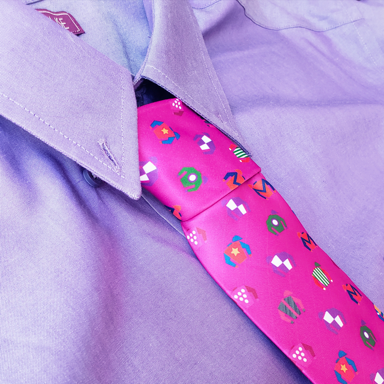 A pink tie with a pattern.