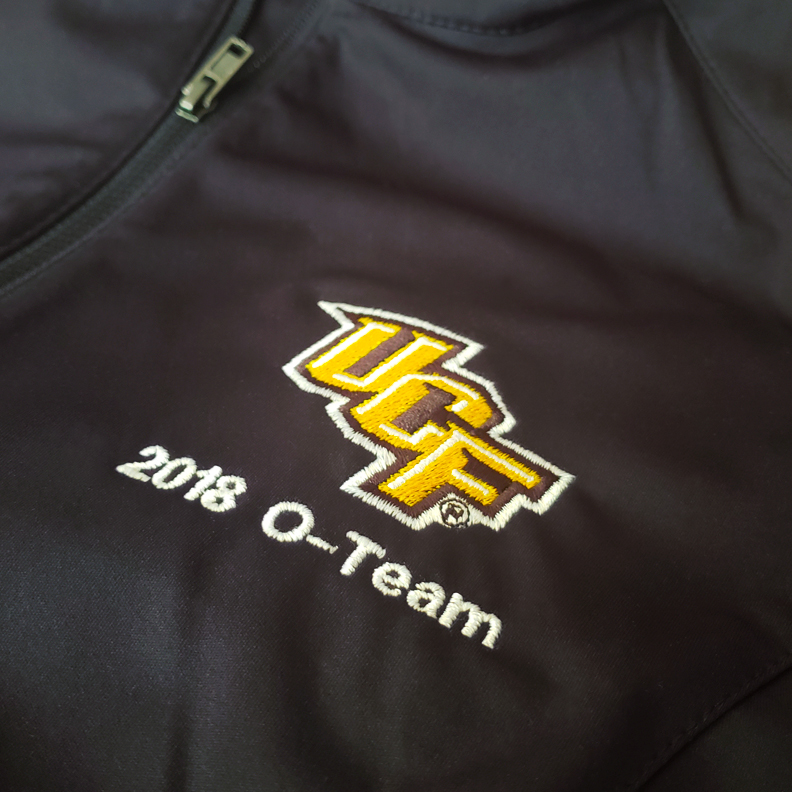 A pullover sweater with the UCF logo and '2018 O-Team' emboridered on the left breast.
